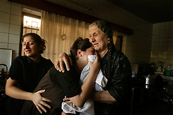 Family members mourn the loss of loved ones  in Baghdad, Iraq on Aug. 20, 2003. The previous day,a family member who was a taxi driver, was waiting for UN officials outside the building when a cement truck packed with explosives detonated outside the offices of the UN headquarters in Baghdad, Iraq, killing 20 people and devastating the facility in an unprecedented suicide attack against the world body. At least 100 people were wounded.