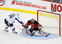 Nov 5, 2008; Newark, NJ, USA; New Jersey Devils goalie Kevin Weekes (1) makes a pad save against Tampa Bay Lightning left wing Jussi Jokinen (36) during the overtime shootout at the Prudential Center. The Devils defeated the Lightning 4-3 in an OT shootout.
