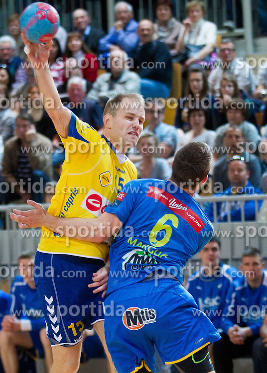 Nejc Poklar of Koper vs Gasper Marguc of Celje during handball match between RK Cimos Koper and RK Celje Pivovarna Lasko in 26th Round of 1st NLB Leasing league 2012/13 on April 14, 2013 in Arena Bonifika, Koper, Slovenia. (Photo By Vid Ponikvar / Sportida)