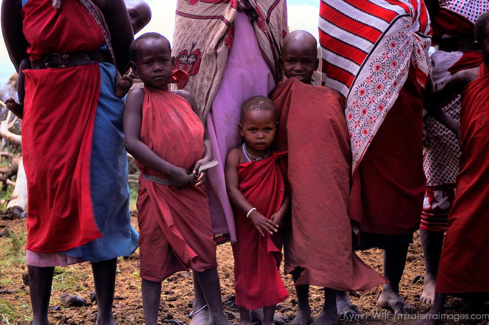 Africa, Kenya, Maasai Mara. Maasai children standing with their mothers at Olanana in the Maasai Mara.