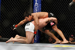 October 24, 2009; Los Angeles, CA; USA; Lyoto Machida (black trunks) defends a takedown attempt by Mauricio Rua(white trunks) during their UFC light heavyweight championship bout at UFC 104.   Machida won via controversial unanimous decison .  Mandatory Credit:  Ed Mulholland