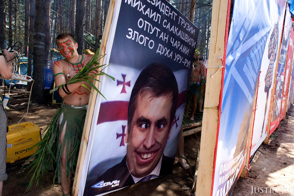 "Pro-Putin Nashi youths putting up a poster demonising Georgian President Mikheil Saakashvili during a summer camp on Lake Seliger in Russia. The poster reads: ""President of Georgia Mikheil Saakashvili is ensnared by charms of evil spirit Uru-ru!"" The yearly camp, organised by the nationalistic group, trains youth in political activism. Georgia, a former Soviet state, has taken a tough anti-Russian stance since Saakashivili took power."