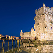 LISBON, Portugal -- Built on a small island near the banks of the Tagus River just to the southwest of downtown Lisbon, the Tower of Belem (or Torre de Belém) dates to 1514-1520. It was part of a defensive network protecting shipping to Lisbon port and beyond during Portugal's Age of Discovery. Paired with the nearby Jerónimos Monastery it is listed as a UNESCO World Heritage Site. In the foreground at left is the wooden walkway that provides the only access to the tower.