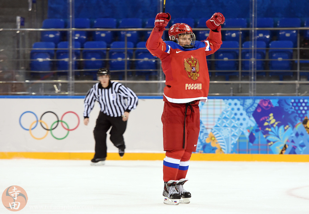 Feb 16, 2014; Sochi, RUSSIA; Russia defenseman Anna Shukina (21) celebrates after scoring a goal against Japan in a women's ice hockey classifications round game during the Sochi 2014 Olympic Winter Games at Shayba Arena.