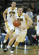 February 2 2011: Iowa Hawkeyes guard Matt Gatens (5) drives down court during the first half of an NCAA college basketball game at Carver-Hawkeye Arena in Iowa City, Iowa on February 2, 2011. Iowa defeated Michigan State 72-52.