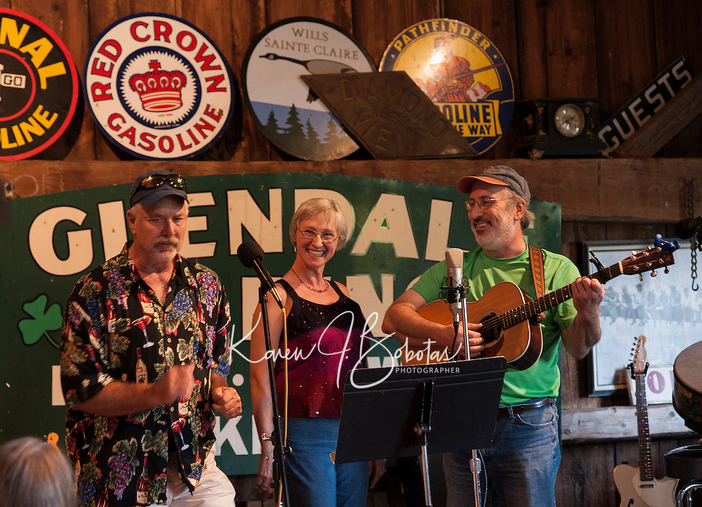 """Rob and Patsy Tacker perform with Duane Johnson during """"Duanefest"""" held in Johnson's 133 year old barn on Saturday with family and friends.   (Karen Bobotas/for the Laconia Daily Sun)"""