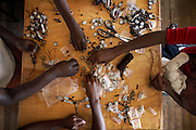 "Women from the Korogocho slum make key rings for the Italian fashion brand MAX&Co. in the Babadogo Community Centre, Nairobi, Kenya, on Monday, Jan. 12, 2009. The women are members of Bidii Shoe Makers and create part of MAX&Co.'s ""ethical fashion"" range in Africa. The programme, in partnership with the ITC, is designed to reduce extreme poverty and empower women. Producing 30 - 50 key-rings per day the women can earn as much as $5 per day, much higher than the average wage for people in this part of Nairobi. The limited edition collection consists of one-of-a-kind handmade accessories such as shoulder-bags, bracelets, key-rings, belts and scarfs."