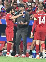 Football - 2019 UEFA Champions League Final - Liverpool vs. Tottenham Hotspur<br /> <br /> Liverpool manager Jurgen Klopp & Mohamed Salah of Liverpool on the touchline, at Wanda Metropolitano, Madrid.<br /> <br /> COLORSPORT/WINSTON BYNORTH