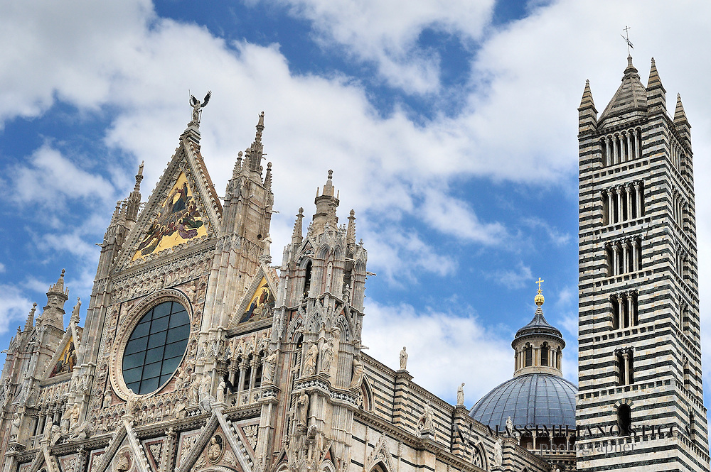 Siena Cathedral (Italian: Duomo di Siena) is a medieval church in Siena, Italy, dedicated from its earliest days as a Roman Catholic Marian church, and now dedicated to Santa Maria Assunta (Most Holy Mary of Assumption).<br /> The cathedral itself was originally designed and completed between 1215 and 1263 on the site of an earlier structure. It has the form of a Latin cross with a slightly projecting transept, a dome and a bell tower. The dome rises from a hexagonal base with supporting columns. The lantern atop the dome was added by Gian Lorenzo Bernini. The nave is separated from the two aisles by semicircular arches. The exterior and interior are constructed of white and greenish-black marble in alternating stripes, with addition of red marble on the fa&ccedil;ade. Black and white are the symbolic colors of Siena, etiologically linked to black and white horses of the legendary city's founders, Senius and Aschius.