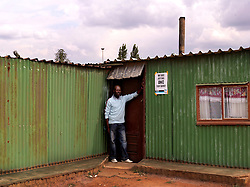 Vusimuzi Cilo, born in 1970, was involved with the Daveyton Student Youth Congress beginning in 1983.  He wrote, directed and produced plays that discussed apartheid and inequality.  These activities initially earned the scorn and harassment of the authorities.  He later became involved in riots and fighting.  One day he returned to his home, he says, to find the police had broken all of the windows and beaten his sister.  Soon after he left home and went into exile..