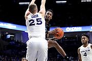 Green Bay forward Josh McNair (12) looks to shoot past Xavier forward Jason Carter (25) during an NCAA college basketball game, Wednesday, Dec. 4, 2019, in Cincinnati. Xavier defeated Green Bay 84-71 (Jason Whitman/Image of Sport)