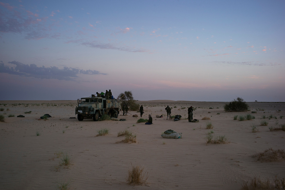 Western Sahara/Zug 2016-10-15<br /> Polisario reinforcements. Polisario troops and equipment on the way from Mijek to the Guerguerat area where the situation is tense. In this image they have stopped in Zug, in the Southeastern Polisario controlled part of Western Sahara, where there is a military post and a borehole.