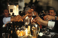 toasting at a party in St. Emilion, France, near Bordeaux