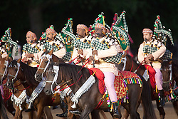 © Licensed to London News Pictures. 13/06/2012. LONDON, UK. Members of the Royal Cavalry of Oman Mounted Band and Musical Ride perform during the annual Beating Retreat parade at Horse Guards Parade in London. On two successive evenings each year in June a pageant of military music, precision drill and colour takes place on Horse Guards Parade in the heart of London when the Massed Bands of the Household Division carry out the Ceremony of Beating Retreat. 300 musicians, drummers and pipers perform this age-old ceremony. The Retreat has origins in the early days of chivalry when beating or sounding retreat pulled a halt to the days fighting. Photo credit: Matt Cetti-Roberts/LNP