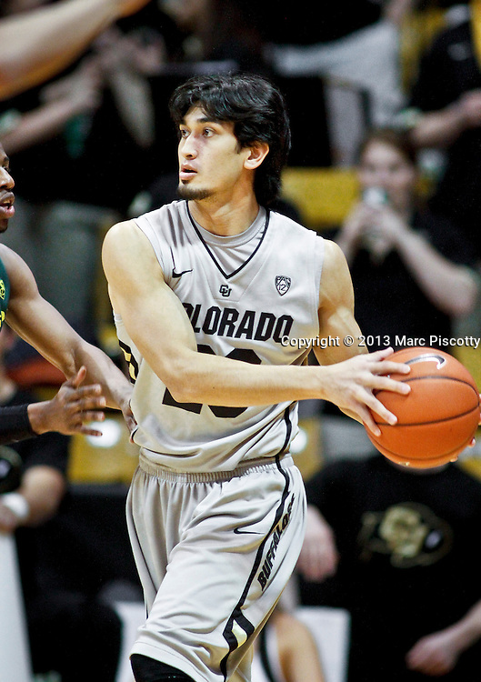 SHOT 3/7/13 8:08:50 PM - Colorado's Sabatino Chen #23 looks to pass against Oregon during their Pac-12 Conference regular season basketball game at the Coors Events Center on the University of Colorado campus in Boulder, Co. Colorado won the game 76-53..(Photo by Marc Piscotty / © 2013)