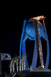 PYEONGCHANG-GUN, SOUTH KOREA - FEBRUARY 09: South Korean figure skater Kim Yu-na prepares to light the cauldron with the Olympic Flame during the Opening Ceremony of the PyeongChang 2018 Winter Olympic Games at PyeongChang Olympic Stadium on February 9, 2018 in Pyeongchang-gun, South Korea. Photo by Ronald Hoogendoorn / Sportida
