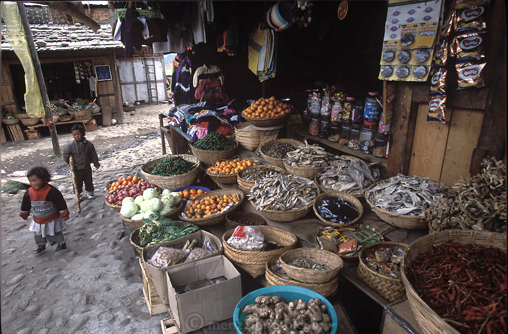 Fish, chilies, ginger, onions, tomatoes and cabbages are among the foods available in a marketplace in Jakar, Bumthang Bhutan. Some of the produce is grown locally and some, like oranges, is trucked from India. A rocklike hard white cheese sold by the piece and a specialty of this area of Bhutan must be chewed for hours before it dissolves.(Supporting image from the project Hungry Planet: What the World Eats) Grocery stores, supermarkets, and hyper and megamarkets all have their roots in village market areas where farmers and vendors would converge once or twice a week to sell their produce and goods. In farming communities, just about everyone had something to trade or sell. Small markets are still the lifeblood of communities in the developing world.