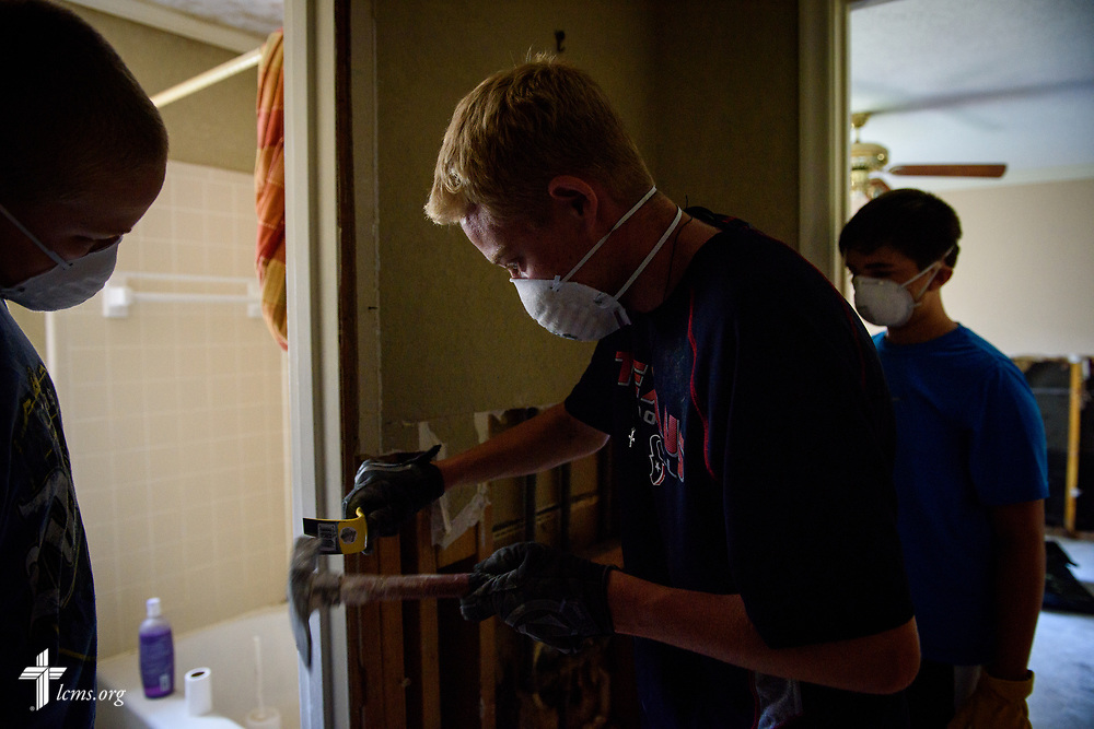 Volunteers from Memorial Lutheran Church, Katy, Texas, including (L-R), Caeden Wisdom, his brother Tyler Wisdom, and Clayton Turner, remove drywall at a home damaged by Hurricane Harvey on Friday, Sept. 1, 2017, in Katy.  LCMS Communications/Erik M. Lunsford
