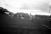 29/04/1964<br /> 04/29/1964<br /> 29 April 1964 <br /> F.A.I. Cup Final replay- Shamrock Rovers v Cork Celtic at Dalymount Park, Dublin. Rovers won the game 2-1. Noonan (Celtic) beats Ronnie Nolan (Rovers) with this shot.