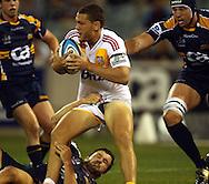Tawera Kerr-Barlow tackled by Adam Ashley Cooper.Super 14 rugby union match, Brumbies v Cheifs, Canberra, Australia. Saturday 19 February 2011. Photo: Paul Seiser/PHOTOSPORT.../SPORTZPICS