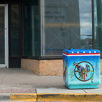 "Richard Yazzie's trash can ""Diversity and Multi-culturalism""  sits at the corner of Coal Street and Third Street in Gallup Thursday."