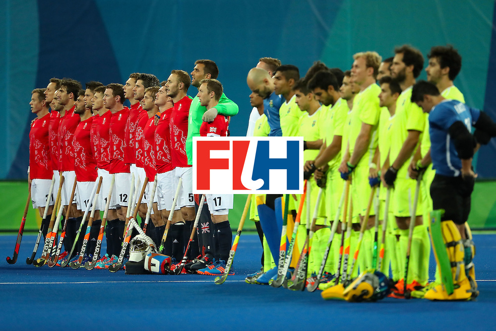 RIO DE JANEIRO, BRAZIL - AUGUST 09:  Great Britain and Brazil stand attended for the national anthems before the hockey game on Day 4 of the Rio 2016 Olympic Games at the Olympic Hockey Centre on August 9, 2016 in Rio de Janeiro, Brazil.  (Photo by Christian Petersen/Getty Images)