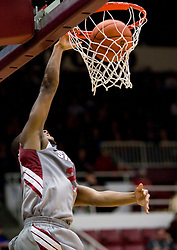 December 16, 2009; Stanford, CA, USA;  Stanford Cardinal guard Jarrett Mann (22) dunks against the Oklahoma State Cowboys during the first half at Maples Pavilion.  Oklahoma State defeated Stanford 71-70.