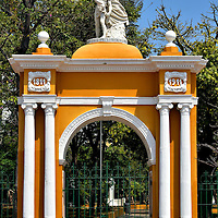 Entrance to Centennial Park in Getsemaní, Cartagena, Colombia<br /> This arch, crowned with a statue of an angel protecting a soldier, celebrates the first 100 years of Cartagena's independence on November 11, 1811. It is also a gateway to Centennial Park. Extensively renovated in 2013, this refreshing greenspace offers plenty of trees, gardens, benches and fountains.  If you are lucky, you might also spot some resident iguanas and sloths.