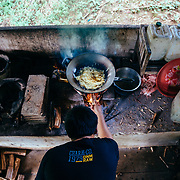 A local forest ranger prepares lunch in the jungle near Chiang Dao, Thailand.
