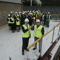 Free to use photograph of the topping out ceremony at the Famous Grouse Experience at the Glenturret Distillery in Crieff... Pictured Scots rugby player Andy Nicol with Derek Brown, Director Brands Heritage and the builders and Higland Distillers employees working on the project<br />