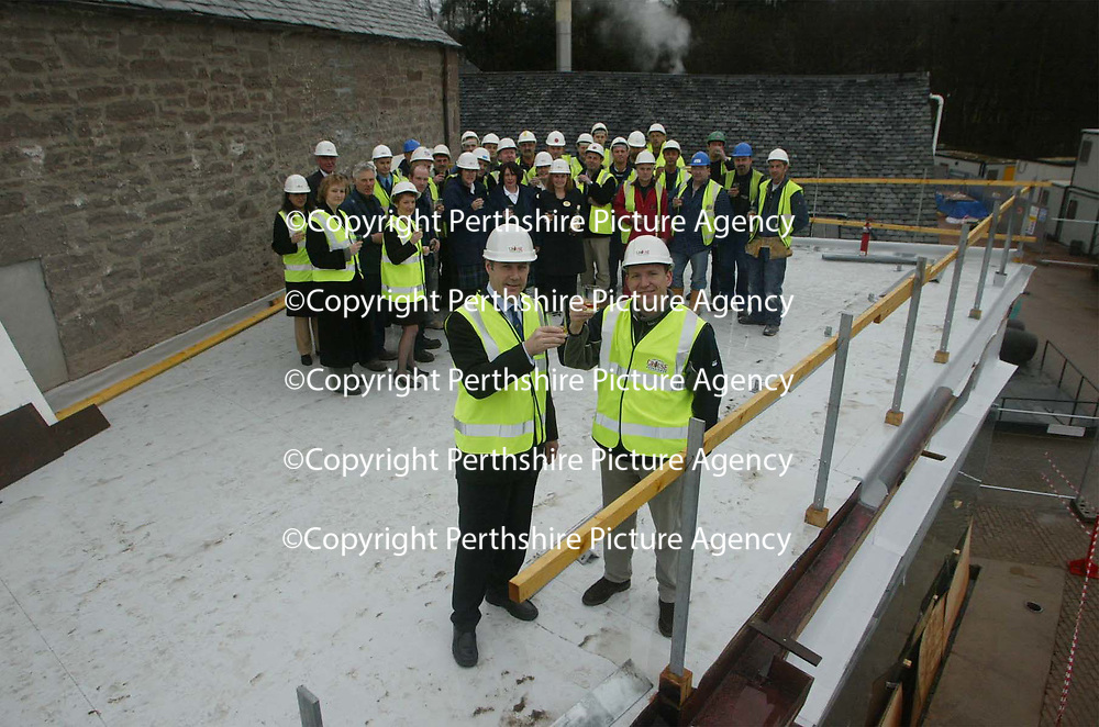 Free to use photograph of the topping out ceremony at the Famous Grouse Experience at the Glenturret Distillery in Crieff... Pictured Scots rugby player Andy Nicol with Derek Brown, Director Brands Heritage and the builders and Higland Distillers employees working on the project<br />see press release by Jaki Martin @ Edrington Group Tel: 01738 493640<br /><br />Picture by Graeme Hart.<br />Copyright Perthshire Picture Agency<br />Tel: 01738 623350  Mobile: 07990 594431