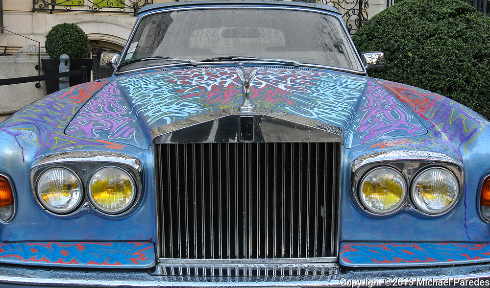 A graffitied Rolls Royce in Paris