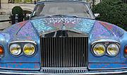 A graffitied Rolls Royce in Paris