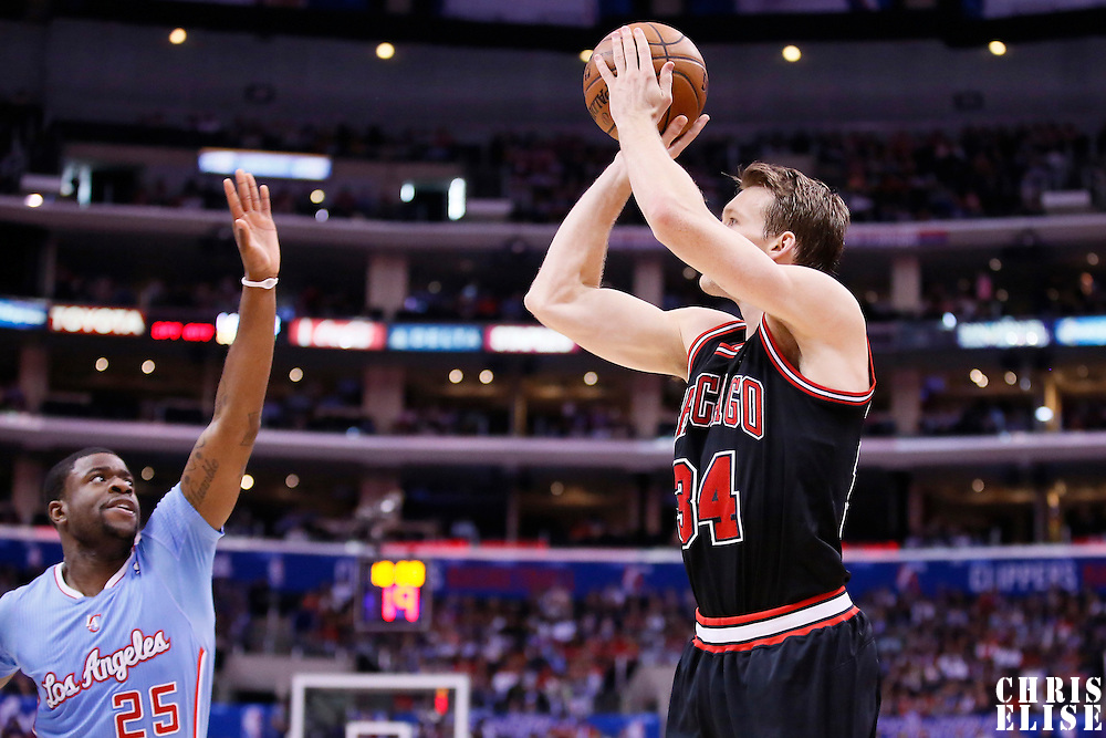 24 November 2013: Chicago Bulls small forward Mike Dunleavy (34) takes a jumpshot over Los Angeles Clippers shooting guard Reggie Bullock (25) during the Los Angeles Clippers 121-82 victory over the Chicago Bulls at the Staples Center, Los Angeles, California, USA.