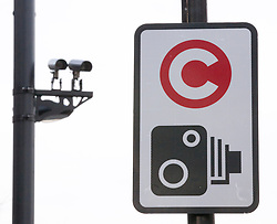 © Licensed to London News Pictures. 18/02/2013. London, UK. On the 10th anniversary of its implementation a congestion charge scheme sign and congestion charge cameras are seen in Lambeth, London, today (18/02/2013). Photo credit: Matt Cetti-Roberts/LNP