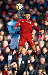 LIVERPOOL, ENGLAND - Saturday, February 24, 2018: Liverpool's Alex Oxlade-Chamberlain and West Ham United's Patrice Evra during the FA Premier League match between Liverpool FC and West Ham United FC at Anfield. (Pic by David Rawcliffe/Propaganda)