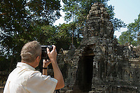 Man Photographing Ancient Temple