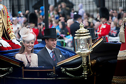 © Licensed to London News Pictures. 05/06/2012. London, UK. The Royal Jubilee celebrations. Duke and Duchess of Cambridge riding along Whitehall as Great Britain is celebrating the 60th anniversary of the countries Monarch HRH Queen Elizabeth II accession to the throne this weekend. Photo credit : Tolga Akmen/LNP