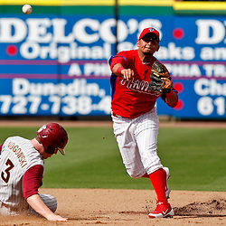February 29, 2012; Clearwater, FL, USA; Philadelphia Phillies right fielder Tyson Gillies (64) forces out Florida State Univeristy base runner John Nogowski (3) during a spring training exhibition game against Florida State University at Bright House Networks Field. The Phillies defeated Florida State 6-1. Mandatory Credit: Derick E. Hingle-US PRESSWIRE