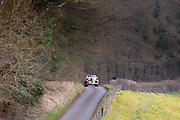 Old classic 1936 Buick 40c open top vintageant convertible car driving through country lanes in the Cotswolds, Oxfordshire. UK