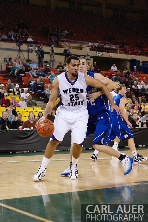November 27th, 2010:  Anchorage, Alaska - Weber State freshman forward Byron Fulton (25) makes a move to the hoop in the Weber State 82-81 victory over the Drake Bulldogs in the third place game of the Great Alaska Shootout.