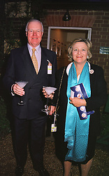 SIR JOCELYN STEVENS and MRS VIVIEN DUFFIELD, at a dinner in London on 24th May 1999.MSK 94