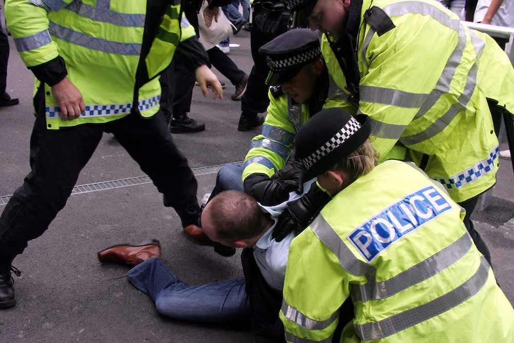 Police arrest a Chelsea before the game. FA Cup Final, Wembley Stadium, 20th May 2007.