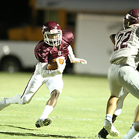Okolona's Jacorrious Standfield finds a lane to run through against Smithville on Friday.