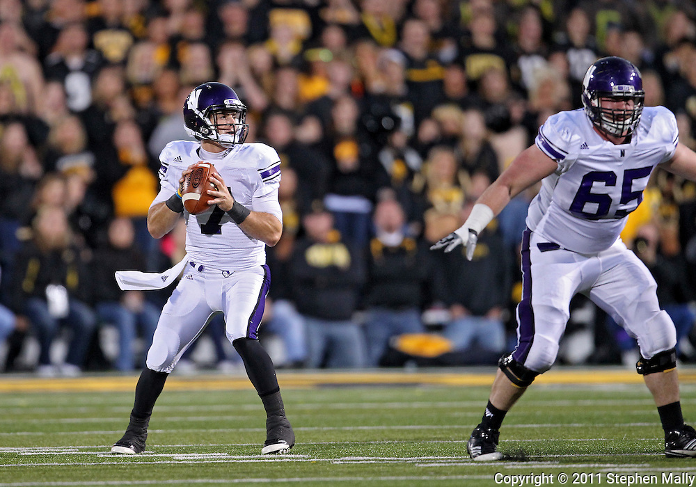 October 15, 2011: Northwestern Wildcats quarterback Dan Persa (7) looks to pass during the first half of the NCAA football game between the Northwestern Wildcats and the Iowa Hawkeyes at Kinnick Stadium in Iowa City, Iowa on Saturday, October 15, 2011. Iowa defeated Northwestern 41-31.