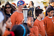 17 JANUARY 2011 - PHOENIX, AZ: Children lead the annual Martin Luther King Day march in Phoenix with a unity torch. About 500 people participated the Martin Luther King Jr March through downtown Phoenix, Monday, Jan. 17. PHOTO BY JACK KURTZ