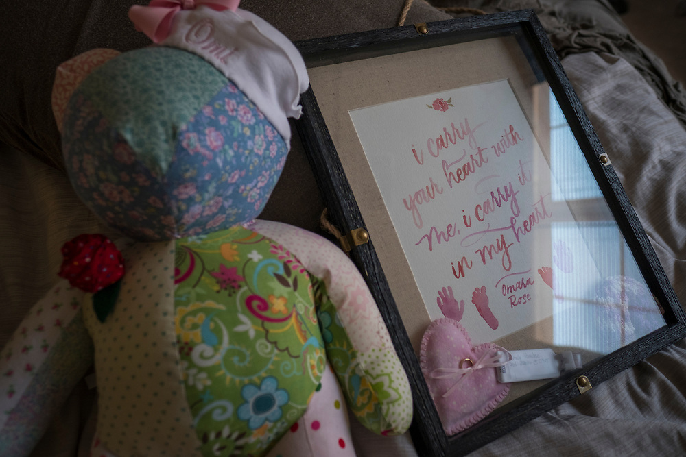 """Fredericksburg, VA  - Lindsey and Matt Paradiso, photographed inside their home, March 12, 2017 in downtown Fredericksburg, Virginia.  Lindsey, 28 years old, and Matt, 31 years old, talk about their pregnancy and subsequent """"late term abortion"""" due to medical complications. Omara Rose, the name the chose for their daughter, was aborted at 25 weeks, February 26, 2016. Photo Justin Ide"""