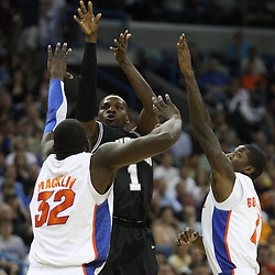Mar 26, 2011; New Orleans, LA; Butler Bulldogs guard Shelvin Mack (1) shoots over Florida Gators center Vernon Macklin (32) and guard Kenny Boynton (1) during the first half of the semifinals of the southeast regional of the 2011 NCAA men's basketball tournament at New Orleans Arena.   Mandatory Credit: Derick E. Hingle