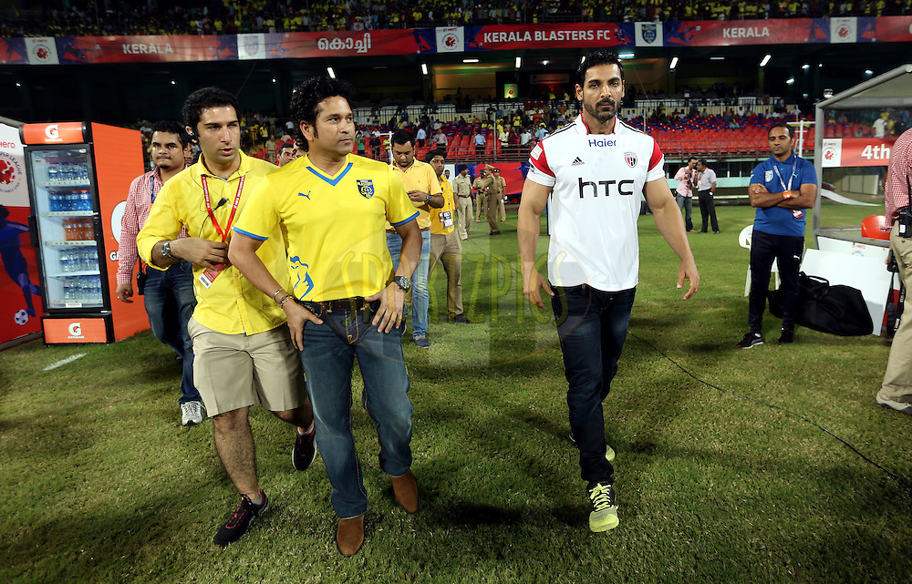 Sachin Tendulkar, Former India cricket player and co-owner of  Kerala Blasters FC and John Abraham , Actor and co-owner of NorthEast United FC City during match 49 of the Hero Indian Super League between Kerala Blasters FC and North East United FC held at the Jawaharlal Nehru Stadium, Kochi, India on the 4th December 2014.<br /> <br /> Photo by:  Sandeep Shetty/ ISL/ SPORTZPICS