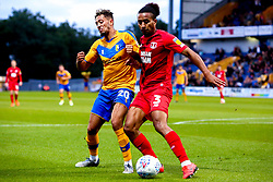 Kellan Gordon of Mansfield Town puts pressure on Joe Widdowson of Leyton Orient - Mandatory by-line: Ryan Crockett/JMP - 20/08/2019 - FOOTBALL - One Call Stadium - Mansfield, England - Mansfield Town v Leyton Orient - Sky Bet League Two